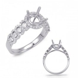 Engagement ring, Halo style with small halos on each side,